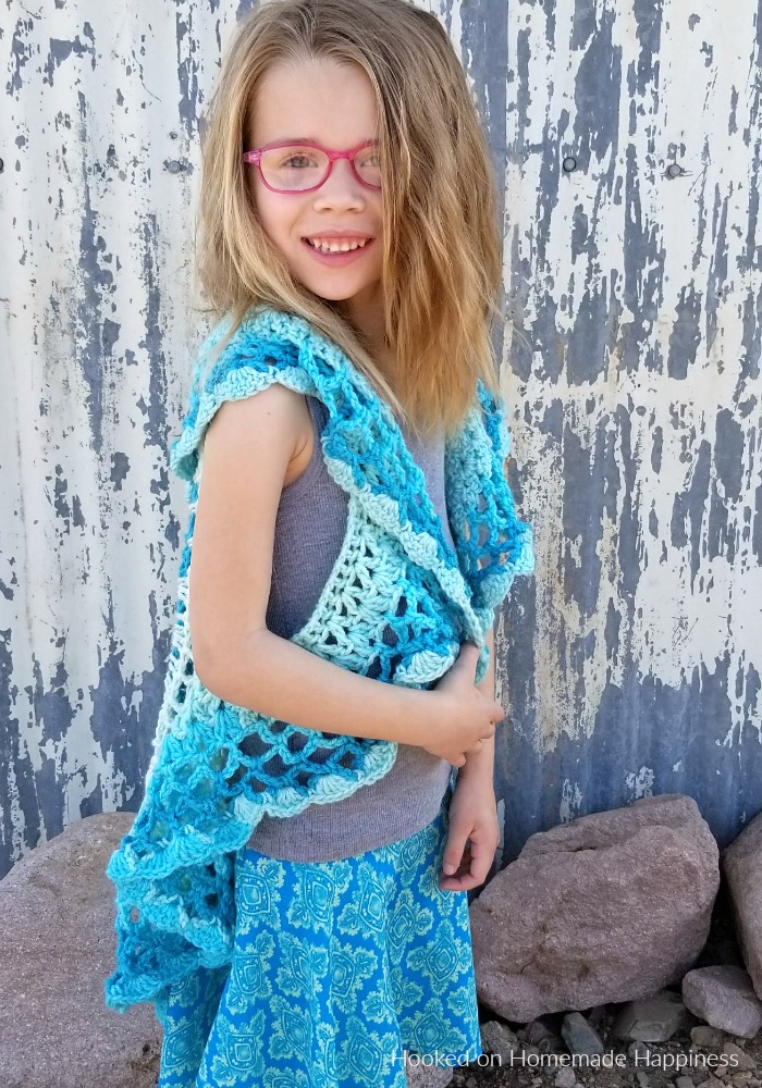 Crochet Circle Vest - I love circle vests! They're such a fun accessory. For this CrochetCircle Vest Pattern I wanted to use a Caron Cake. Because who doesn't love stripes without weaving in all the ends, amiright?