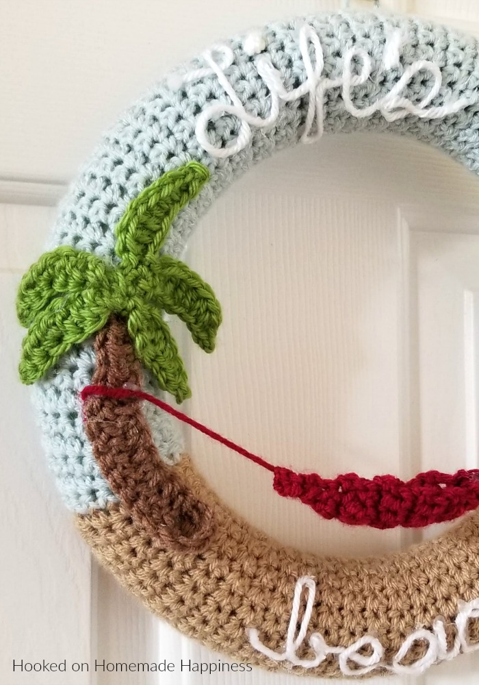 """Making crochet wreaths is so much fun and I had a blast making this """"Life's a Beach"""" Summer Crochet Wreath! Once you know how to make the wreath base, the possibilities are endless."""