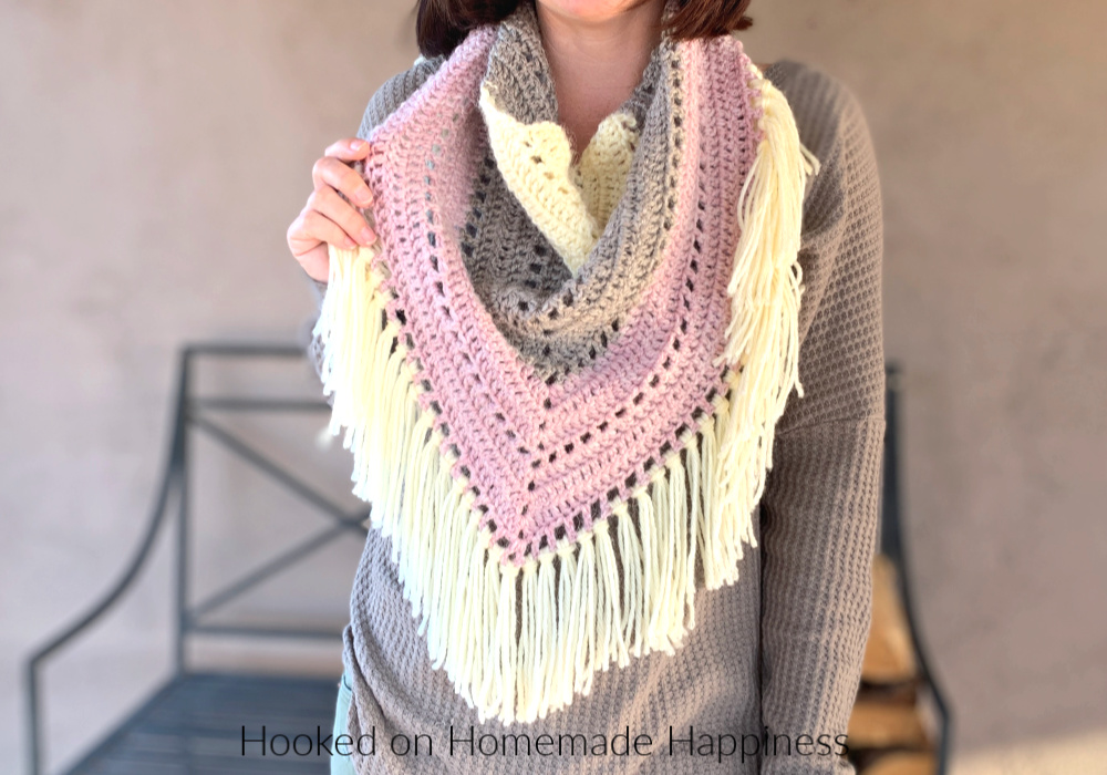 Piece of Cake Triangle Scarf - The Piece of Cake Triangle Scarf is just that...  a piece of cake! It's a super easy, beginner triangle scarf. And it's the perfect size for your favorite yarn cake! I used three colors I had in my stash, but I've also made this using one yarn cake.