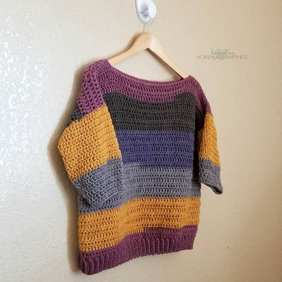Everygirl Crochet Sweater Pattern - This comfy, easy to make Everygirl Crochet Sweater is the perfect addition to your fall wardrobe. I used 2 Caron Cakes to make this sweater. When picking out my skeins, I made sure to find ones that had the same starting color so the stripes on the front and back out (almost) match up.
