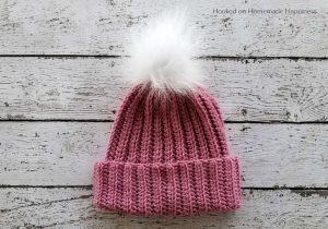 Classic Beanie Crochet Pattern - This Classic Beanie Crochet Pattern has a classic design, but is made a little differently than your typical crocheted hat. It's worked as a rectangle and then sewn into a hat. There's a little bit of ribbing to add some subtle texture and the double brim will help keep ears extra warm.