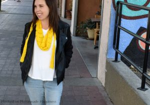 Sunshine Crochet Scarf Pattern - Let the warm sunshine in with this Sunshine Crochet Scarf Pattern! It's made with a super lightweight cotton and that makes it perfect for warmer weather. It hangs loose around the neck so you don't have to worry about getting too warm with this scarf.