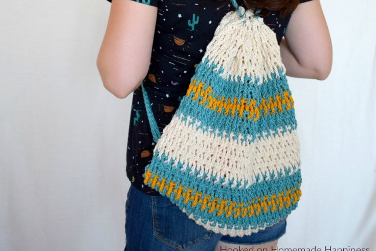 Daytrip Cinch Backpack Crochet Pattern - The Daytrip Cinch Backpack Crochet Pattern is perfect for your next outing! It's made of durable cotton, with a solid stitch, and can hold all the things you might need. #crochet #freecrochetpattern #crochetbag