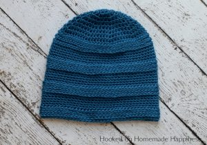 Textured Stripe Beanie Crochet Pattern - The Textured Stripe Beanie Crochet Pattern has a subtle striping design that's created by using different stitches. #crochetpattern #freecrochetpattern