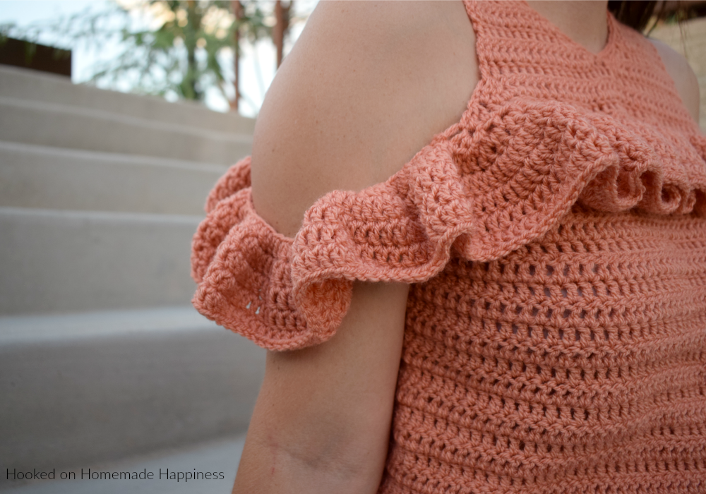 Cold Shoulder Crochet Top Pattern -The Cold Shoulder Crochet Top Pattern is such a fun and flirty top! It's made with DK weight yarn so it's not too heavy. Perfect for Fall and Spring!