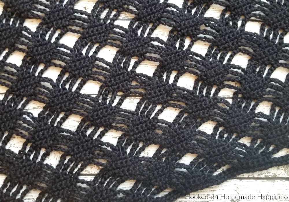 Spider Web Cardigan Crochet Pattern - This Spider Web Cardigan Crochet Pattern is just what you need for October! And what I love about it is that you can wear it year round. It's Halloween-ish, but not so obvious that you can't pull it off anytime.