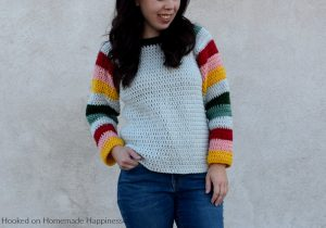 Mod Christmas Sweater Crochet Pattern - This Mod Christmas Sweater Crochet Pattern is a raglan style sweater with cute striped sleeves. I went with some modern Christmas colors for my sleeves, but they can be made in any color combination.
