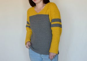 Tailgate Sweater Crochet Pattern - The Tailgate Sweater Crochet Pattern is a lightweight sweater that can easily be customized to show off your favorite team! But of course you can just choose a favorite color combination (like I did :) ) There are so many things I love about this sweater. The slight v neck, the color blocking, the stripes on the sleeves, the DK weight yarn... So. Many. Things.