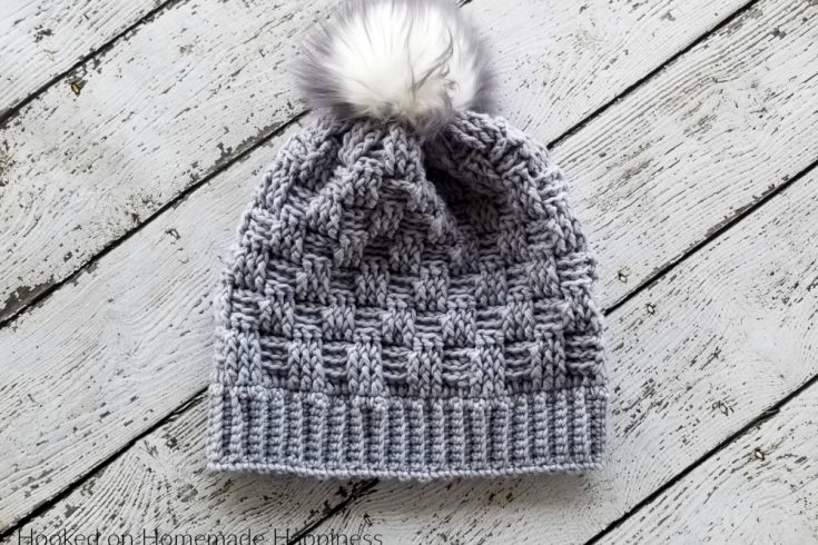 Woven Beanie Crochet Pattern - The Woven Beanie Crochet Pattern uses the basket weave stitch to create this pretty woven look. I love all the different textures of this beanie with the ribbed brim, the basket weave, and the fun pom pom.