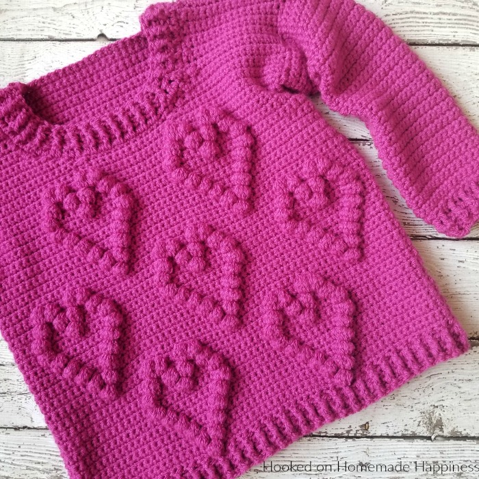 I Heart You Sweater Crochet Pattern - This adorable I Heart You Sweater Crochet Pattern has a fun heart pattern made with one of my favorite stitches... the bobble stitch!