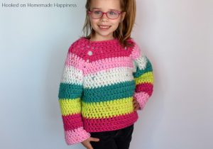 Kid's Chunky Raglan Crochet Pattern - The Kid's Chunky Raglan Sweater Crochet Pattern is made with 2 Chunky Caron Cakes. Because of the raglan style and the chunky yarn, it works up so fast. I had the entire sweater done in just one afternoon!