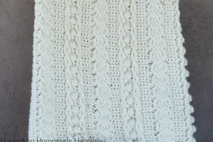 Cable Crochet Blanket Pattern - The Crochet Cable Blanket Pattern is full of beautiful texture and is easier than it looks! With a 4 row repeat you can create these gorgeous cables.