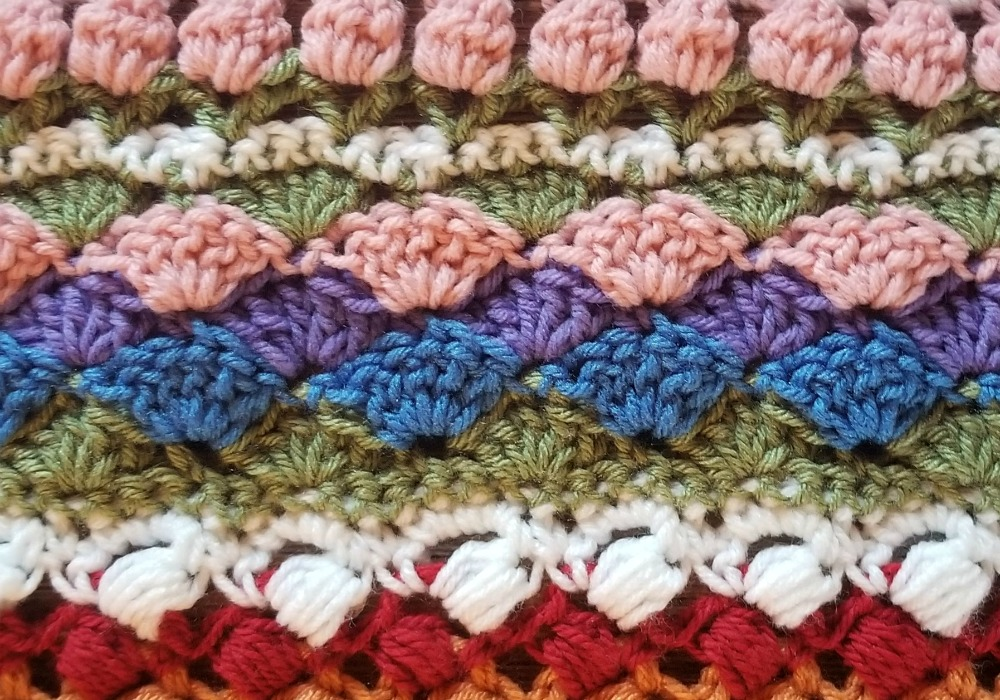 Welcome to Part 13 of the Stitch Sampler Scrapghan CAL! Only a couple weeks left until we're all done! This week is the Shell Stitch. It's a pretty stitch that I've used on a couple hat designs.