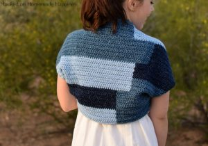 Patchwork Shrug Crochet Pattern - The fun design in this Patchwork Shrug Crochet Pattern is made as one piece! It's one rectangle with a little bit of sewing to make the shrug shape.