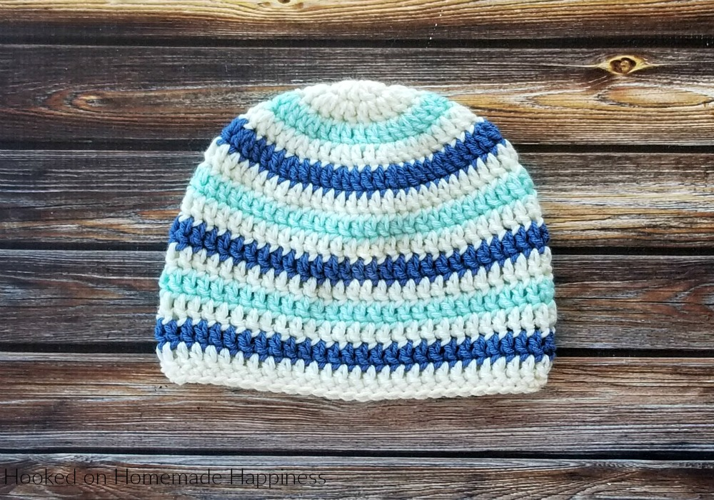Basic Striped Beanie Crochet Pattern - This Basic Striped Beanie Crochet Pattern has endless color possibilities! This child sized beanie is an easy pattern and I have a video tutorial to show how I like to change colors when working in the round.