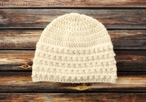 Snowdrop Beanie Crochet Pattern - The Snowdrop Beanie Crochet Pattern starts out with a simple double crochet. Then it uses a combination of half double crochet and the Pebble Stitch to create the pretty textured brim.