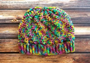 Vertigo Beanie Crochet Pattern - The Vertigo Beanie Crochet Pattern is such a fun beanie! It uses a combination of front post double crochet and back post double crochet to make this fun swirl-like design. And it's reversible! I might like the inside even better.