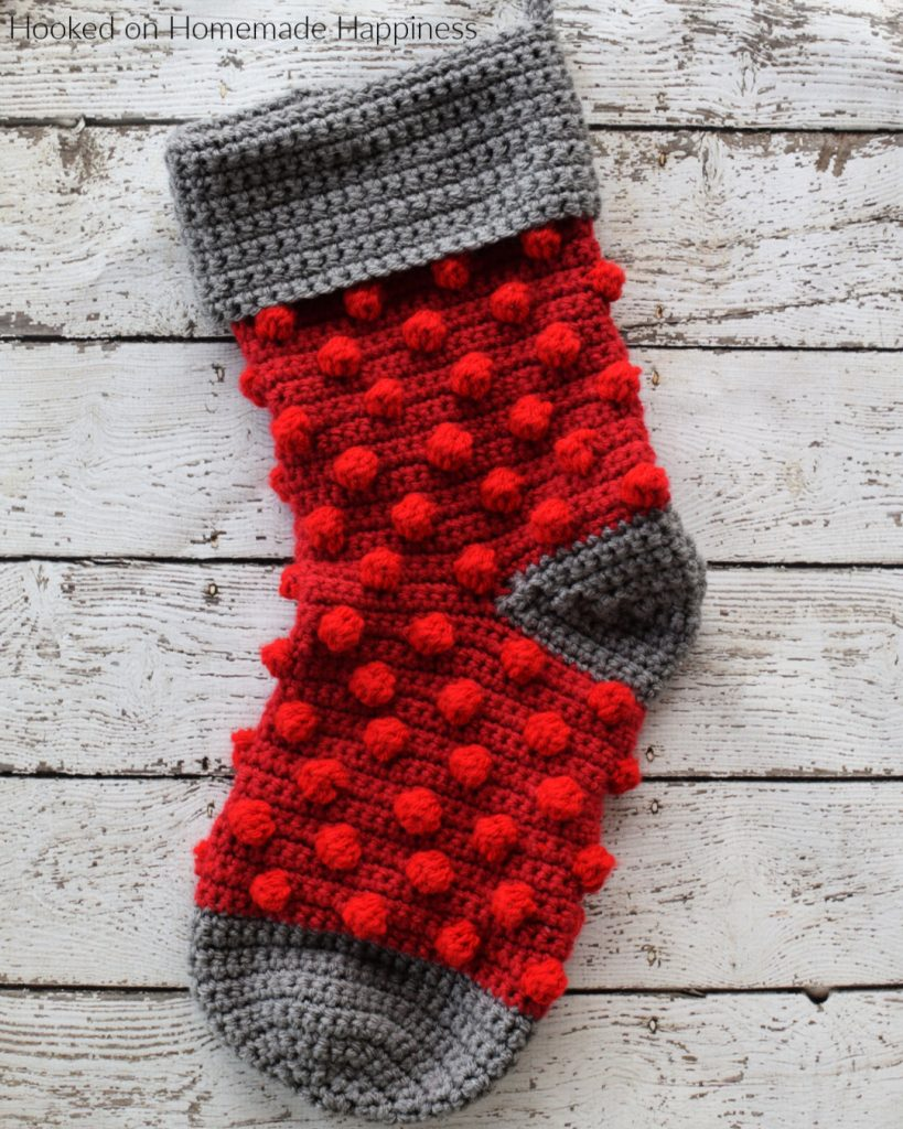Bobble Crochet Stocking Pattern - This Bobble Crochet Stocking Pattern is so festive and cute! Because of the bulky weight yarn, it works up surprisingly fast. This stocking is a good size and can hold LOTS of goodies from Santa!