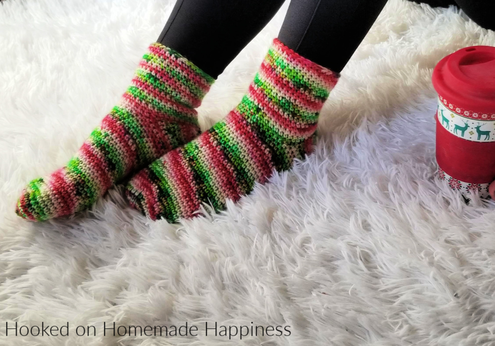 Basic Crochet Socks Pattern - These Basic Crochet Socks Pattern use worsted weight yarn and are all single crochet! They work up surprisingly fast and are beginner friendly. A great Holiday gift.