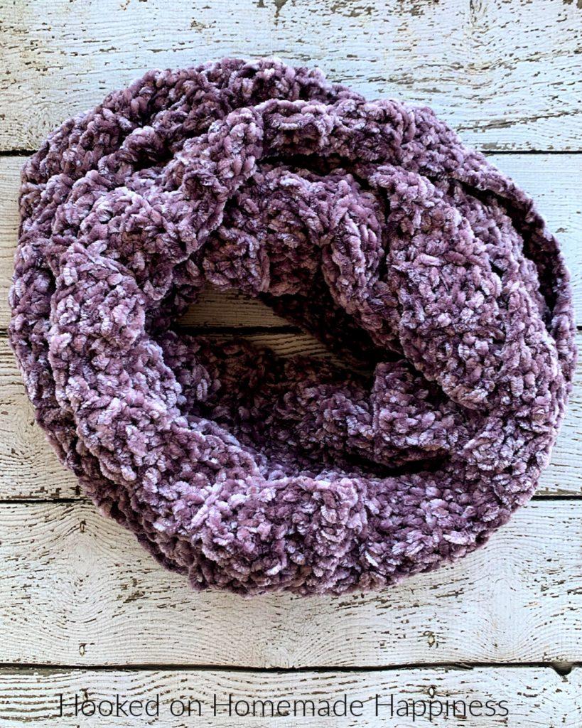 Easy Velvet Infinity Scarf Crochet Pattern - The Easy Velvet Infinity Scarf Crochet Pattern uses just 1 skein of Bernat Velvet yarn. The velvet yarn is so soft and luxurious. It makes such a soft and cozy winter scarf.