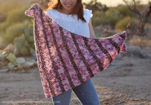 Petal Shawl Crochet Pattern - The Petal Shawl Crochet Pattern uses the pretty cluster V stitch. It creates such a pretty design that reminds me of petals. With just a simple 2 row repeat you can create this gorgeous shawl!