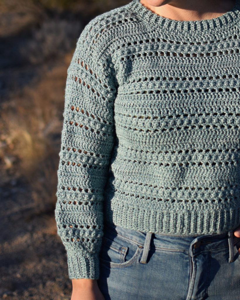 Kindred Sweater Crochet Pattern- The Kindred Sweater Crochet Pattern is my new favorite sweater! It uses a fun and easy stitch combination. I used double crochet, chain stitches, and the berry stitch to create this texture.