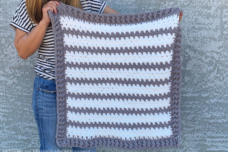 Braydon Baby Blanket Crochet Pattern - The Braydon Baby Blanket Crochet Pattern is an easy & quick baby blanket. Because of the super bulky yarn and the 1 row repeat, I was able to make it in just a day!