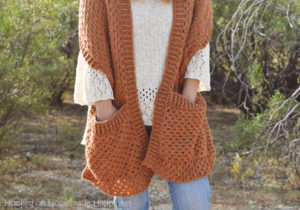 Persimmon Pocket Shawl Crochet Pattern - The Persimmon Pocket Shawl Crochet Pattern is the perfect pattern to get you ready for fall! It uses the classic granny stitch with a textured ribbing.